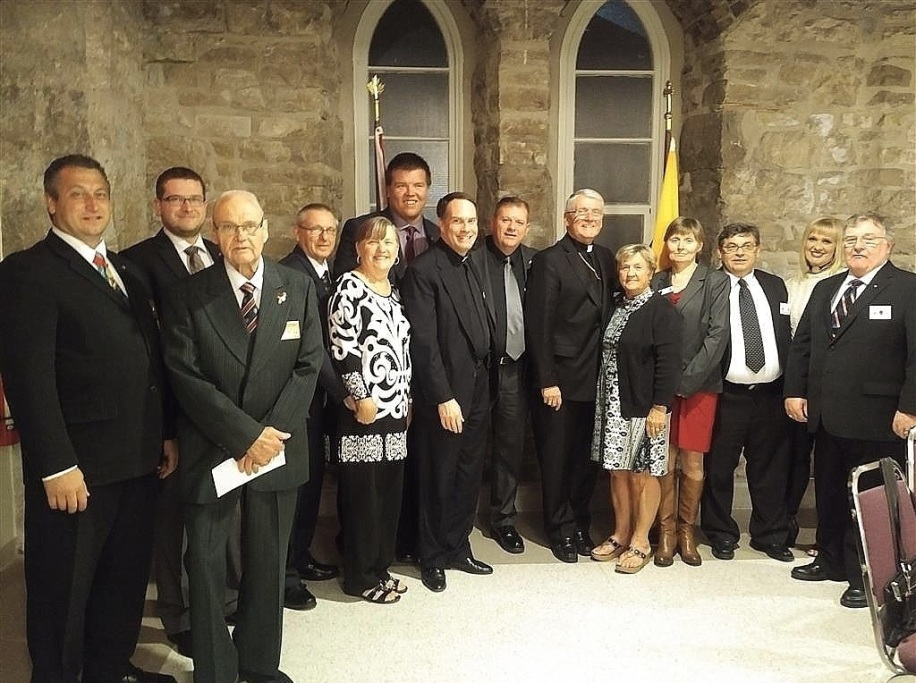 The Basilica of Our Lady Immaculate, Guelph, was the scene for the recent Ontario K of C, (District 69) Annual Bishop's Charity Dinner in honour of The Most Reverend Douglas Crosby, OMI, Bishop of Hamilton. Attending (L to R) Ontario State Deputy Alain Cayer, Chris Pugh, unknown guest, Wayne Curry, Marilyn Curry, Tim Ferguson, Fr. Larry Parent, GK Dave Obermeyer, Bishop Douglas Crosby, Margaret Hughes, Anna Szabo, DGK Mike Szabo, Birgit Obermeyer, PGK Brian Hughes.