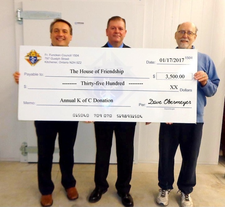 The K of C recognizes the important role The House of Friendship plays in the community. Accepting a $3,500 donation from Council 1504 is Executive Director, Mr. John Neufeld. From l to r, John Neufeld, GK Dave Obermeyer and Mr. Anthony Bender, HOF Community Services Program Director.